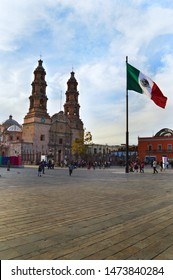 Acuascalientes / Mexico - February 02, 2019: Cathedral and flag of Mexico in downtown Aguascalientes Mexico