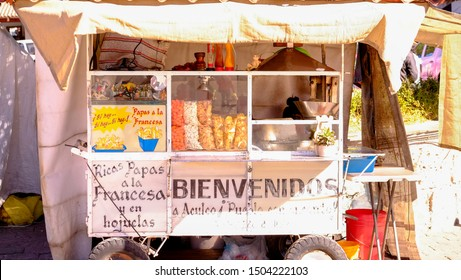 Aculco, Mexico - January, 9th, 2018: Street food vendor stall with snack on sunny day
