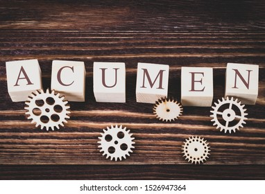 acumen word made with building blocks on wooden background, concept, wooden gears, vignetting and toning image