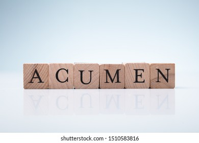 Acumen Word Made With Wooden Blocks On Reflective Desk