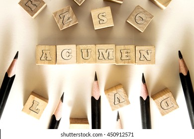 ACUMEN word written on building block concept