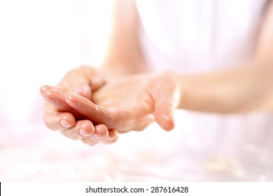 Acupressure, hand massage.The woman in the spa salon for a massage hand