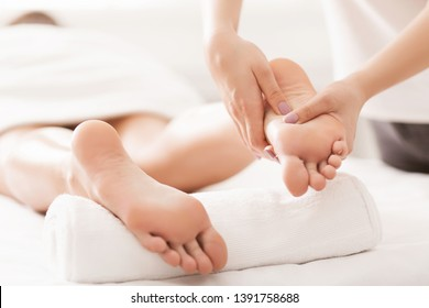 Acupressure And Reflexology Concept. Foot Massager Oppresses Energy Flow Points