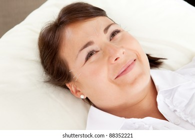Acupuncture patient smiling and looking up