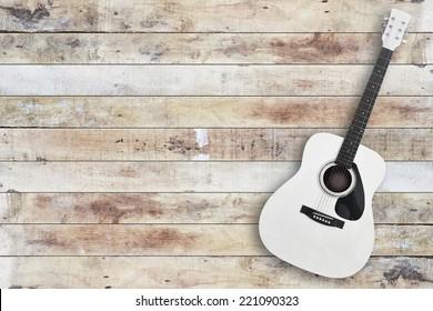 acustic guitar on wooden floor background