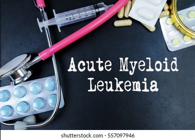 Acute Myeloid Leukemia word, medical term word with medical concepts in blackboard and medical equipment.