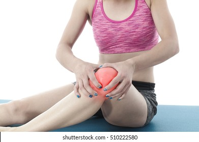 Acute pain in a knee. Woman holding hand to spot of knee aches.