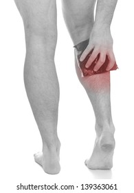 Acute pain in a man calf. Male holding ice pack  on calf-aches. Medical concept photo. Isolation on a white background.