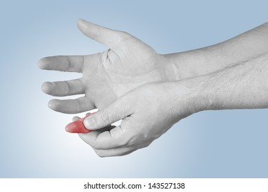 Acute pain in a man finger. Male holding hand to spot of neck-aches.