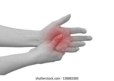 Acute pain in a man palm. Female holding hand to spot of palm-ache. Concept photo with Color Enhanced blue skin with read spot indicating location of the pain. Isolation on a white background.