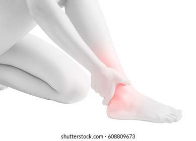 Acute pain in a woman  ankle isolated on white background. Clipping path on white background