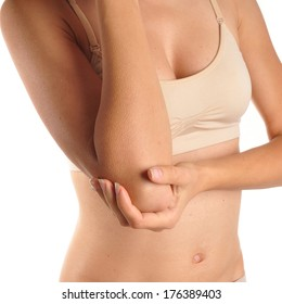 Acute pain in a woman elbow. Female holding hand to spot of elbow pain.