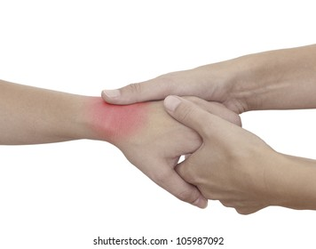Acute pain in a woman wrist. Female holding hand to spot of wrist pain.