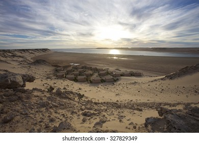AD DAKHLA, MOROCCO, NOV 21: Coast of Southern Morocco with the Atlantic Ocean and a few bungalows and the desert all around. Dakhla Lagoon, Morocco 2010