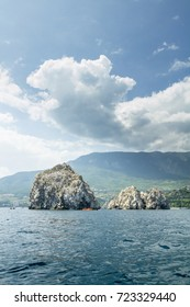 Adalary. Rocks of the Crimea. Two rocks in the sea.Adalars against the background of mountains.