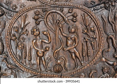 Adam and Eve in the Garden of Eden before the tree of knowledge. A fragment of an ancient wooden door in the Holy Sepulchre. Jerusalem. Isrsel.