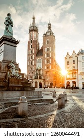Adam Mickiewicz monument and St. Mary's Basilica on Main Square in Krakow, Poland