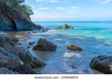 Adaman Sea on the beach against the rocks and stones in  Koh Lanta island coast, Krabi, Thailand.