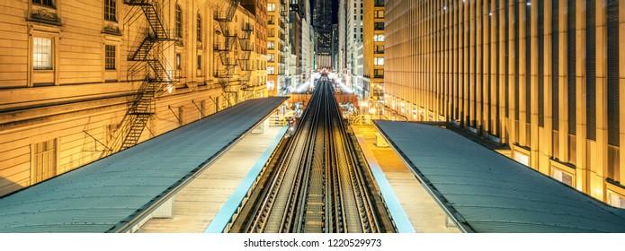 Adams Wabash Train line towards Chicago Loop in Chicago by night