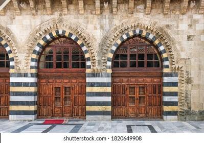 adana grand mosque, historic wooden doors and courtyard, ulucami