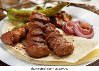 Adana kofte with flatbread and vegetables