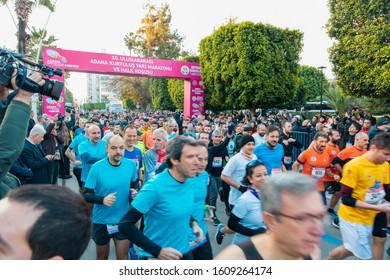 Adana, Seyhan / Turkey - 01-05-2019 : Marathon runners running at public city marathon. 10th International Adana Liberation, independence Half Marathon runners and marathon athletes at January 5th