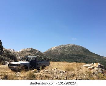 adandoned old car greek island blu sky