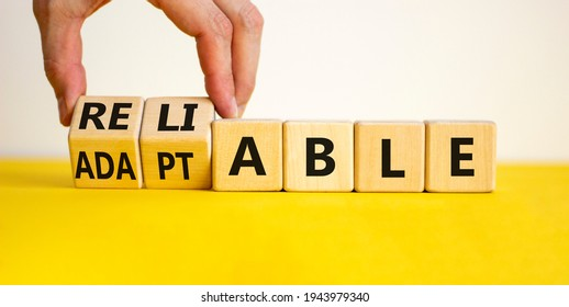 Adaptable or reliable symbol. Businessman turns wooden cubes and changes the word adaptable to reliable. Beautiful white background, copy space. Business and adaptable or reliable concept.