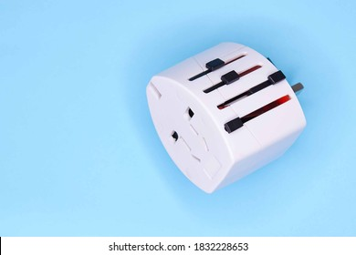 adapter electric adapter multifunctional white on a blue background
