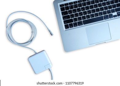Adapter power cord charger of laptop computer isolated on white background, Top view