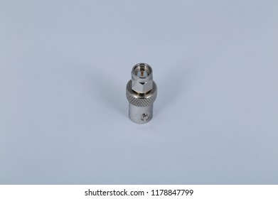Adaptor with BNC to SMA on a white background
