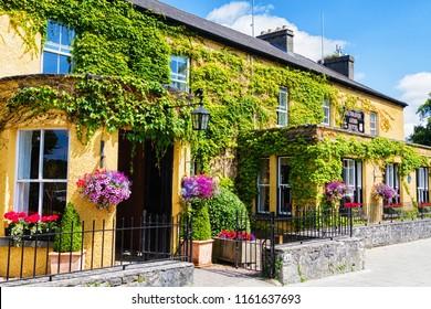 ADARE, IRELAND - JULY 10, 2018: Colorful yellow house in Adare, Ireland