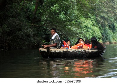 ADAVI, INDIA - DEC 27:Tourists go around in a bowl boat through the river Kallar on December 27,2015 in Adavi, Kerala, India. Eco tourism is promoted by the Government in the forest regions of Adavi.