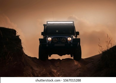 Adazi, LV - APR 1, 2016: Jeep Wrangler JK Unlimited Rubicon Recon in desert with led bar on roof