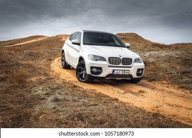 Adazi, LV - APR 6, 2014: BMW X6 at the off road