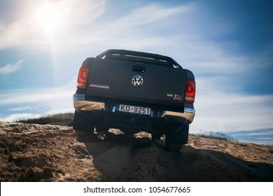 Adazi, LV - AUG 25, 2017: New VW Amarok 2017 in sands during off road test drive