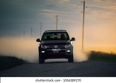 Adazi, LV - AUG 25, 2017: Volkswagen Amarok V6 on dirt road outside the city