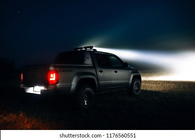 Adazi, LV - SEP 9, 2018: Volkswagen Amarok Aventura 4MOTION 3.0 V6 TDI Canyon at the night with led bar lamps at the country coad