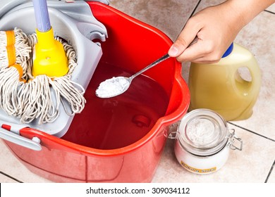 Add baking soda to floor cleaner and water for house cleaning
