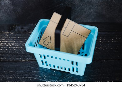 add to cart concept: cardboard online delivery parcel in shopping basket