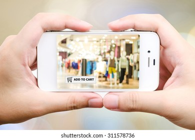 Add to cart over blur store background on smart phone, business, E-commerce, on line shopping background