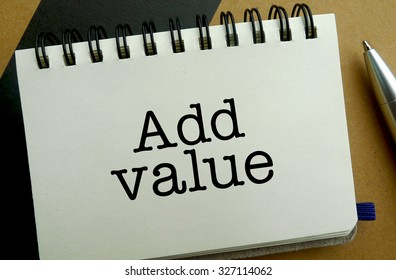 Add value memo written on a notebook with pen