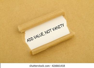 ADD VALUE, NOT VANITY message written under torn paper.