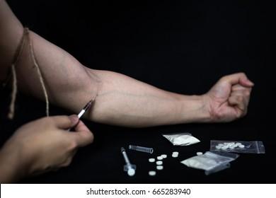 Addict man make injection of drugs