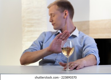 Addicted man refuses to drink a glass of wine