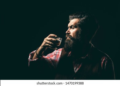 Addicting to alcoholic drink. Alcoholism. Handsome stressed businessman in formal wear holding a glass of whiskey in his hand. Stop alcohol addiction