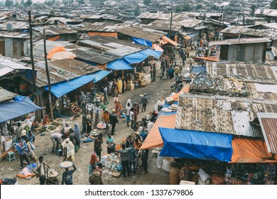 ADDIS ABABA, ETHIOPIA - AUGUST 28, 2018: unidentified people bargain food in a street of Addis Ababa, Ethiopia.