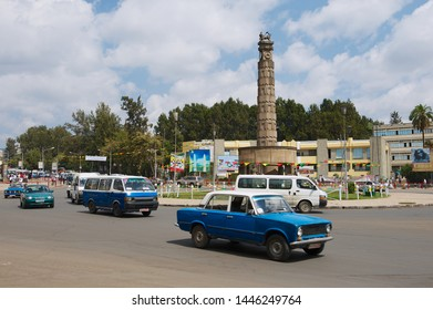 Addis Ababa, Ethiopia - January 18, 2010: Cars pass but the square with the Arat Kilo monument in Addis Ababa, Ethiopia. Monument commemorates Ethiopia's liberation from Fascist Italy.