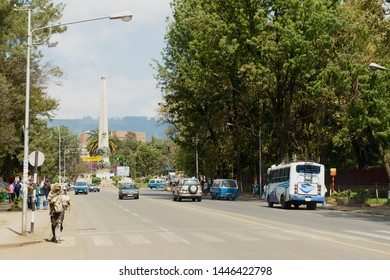 Addis Ababa, Ethiopia - January 18, 2010: View to the street with the Yekatit 12 monument at the background in downtown Addis Ababa, Ethiopia.