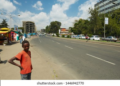 Addis Ababa, Ethiopia - January 18, 2010: Unidentified teenager stands at a sidewalk at the street in downtown Addis Ababa, Ethiopia.